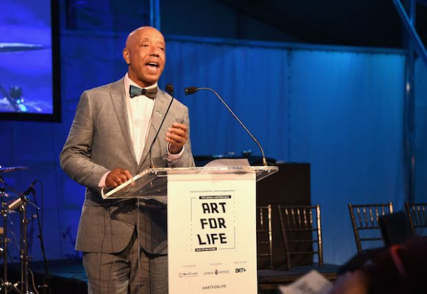 BRIDGEHAMPTON, NY - JULY 16: CEO of Rush Communications Russell Simmons speaks onstage during Rush Philanthropic Arts Foundation's 2016 ART FOR LIFE Benefit at Fairview Farms on July 16, 2016 in Bridgehampton, New York. (Photo by Nicholas Hunt/Getty Images for Rush Philanthropic Arts Foundation)
