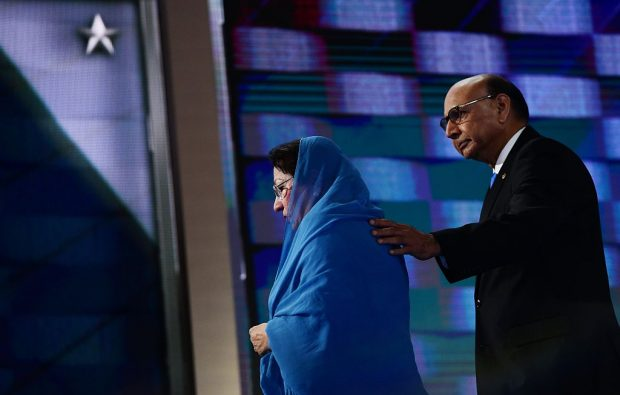 Khizr Khan (R), accompanied by his wife Ghazala Khan (L), walks off stage after speaking about their son US Army Captain Humayun Khan who was killed by a suicide bomber in Iraq 12 years ago, on the final night of the Democratic National Convention at the Wells Fargo Center, July 28, 2016 in Philadelphia, Pennsylvania. / AFP / Robyn Beck (Photo credit should read ROBYN BECK/AFP/Getty Images)