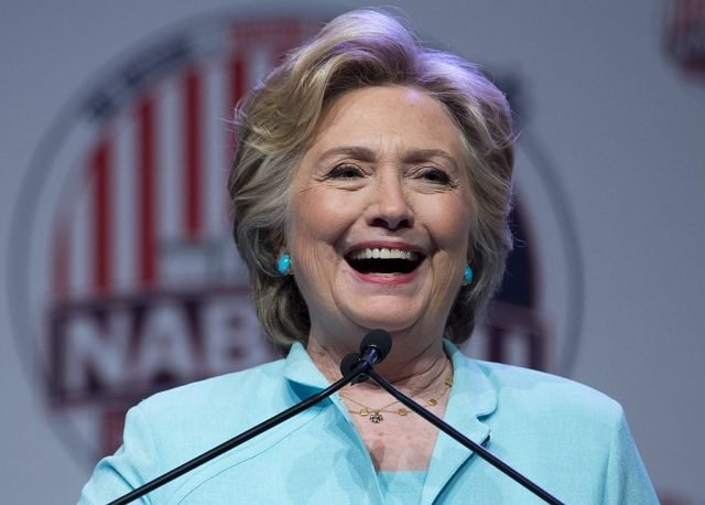 Democratic presidential nominee Hillary Clinton speaks during the National Association of Black Journalists(NABJ) and National Association of Hispanic Journalists(NAHJ) joint convention in Washington, DC, August 5, 2016. / AFP / SAUL LOEB (Photo credit should read SAUL LOEB/AFP/Getty Images)