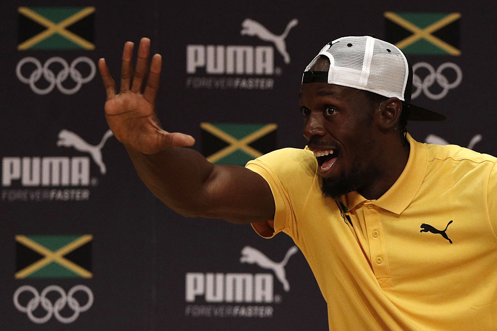 Usain Bolt Is putting an end to boring press conferences. (Photo credit should read ADRIAN DENNIS/AFP/Getty Images)