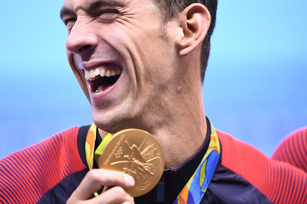 Michael Phelps poses with his gold medal during the podium ceremony of the Men's swimming 4 x 100m Medley Relay Final at the Rio 2016 Olympic Games (Getty Images)