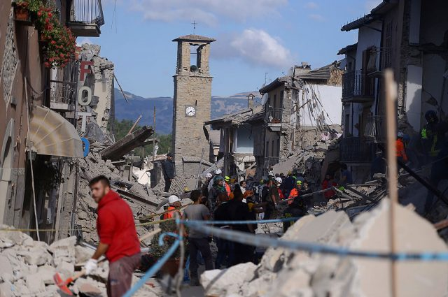 Rescuers and firemen inspect the rubble of buildings in Amatrice on August 24, 2016 after a powerful earthquake rocked central Italy. The earthquake left 38 people dead and the total is likely to rise, the country's civil protection unit said in the first official death toll. Scores of buildings were reduced to dusty piles of masonry in communities close to the epicentre of the pre-dawn quake in a remote area straddling the regions of Umbria, Marche and Lazio. (Photo: FILIPPO MONTEFORTE/AFP/Getty Images)