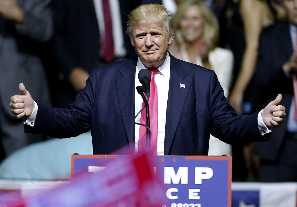 Donald Trump gives thumbs up to the crowd at a rally at the Mississippi Coliseum on August 24, 2016 (Getty Images)