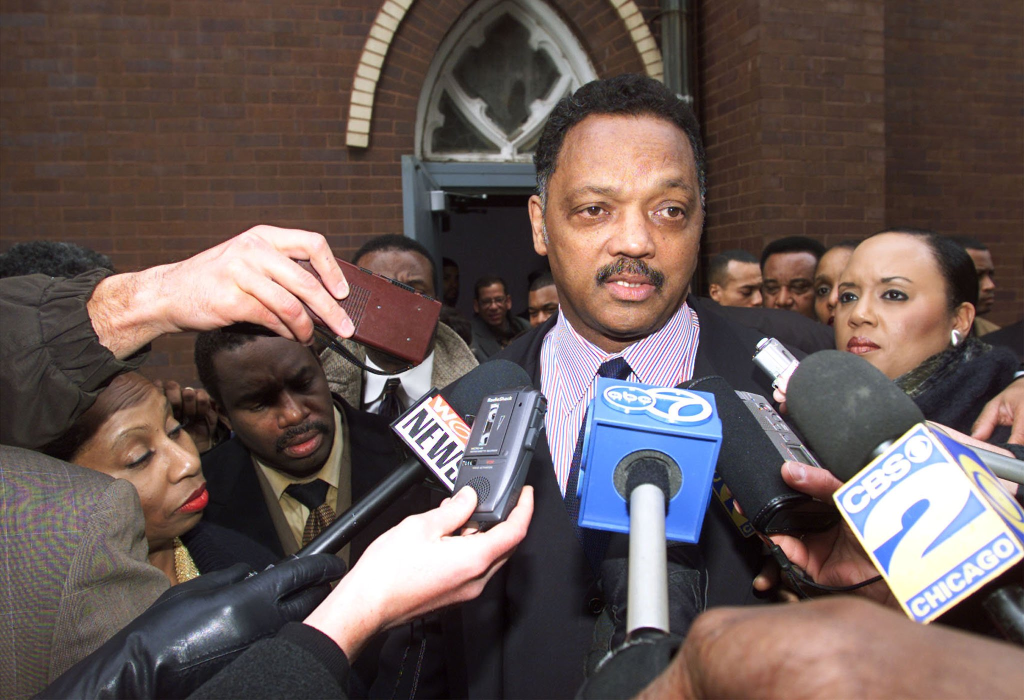 Jesse Jackson is mobbed by the media as he leaves the Salem Baptist Church in Chicago (Reuters Pictures)