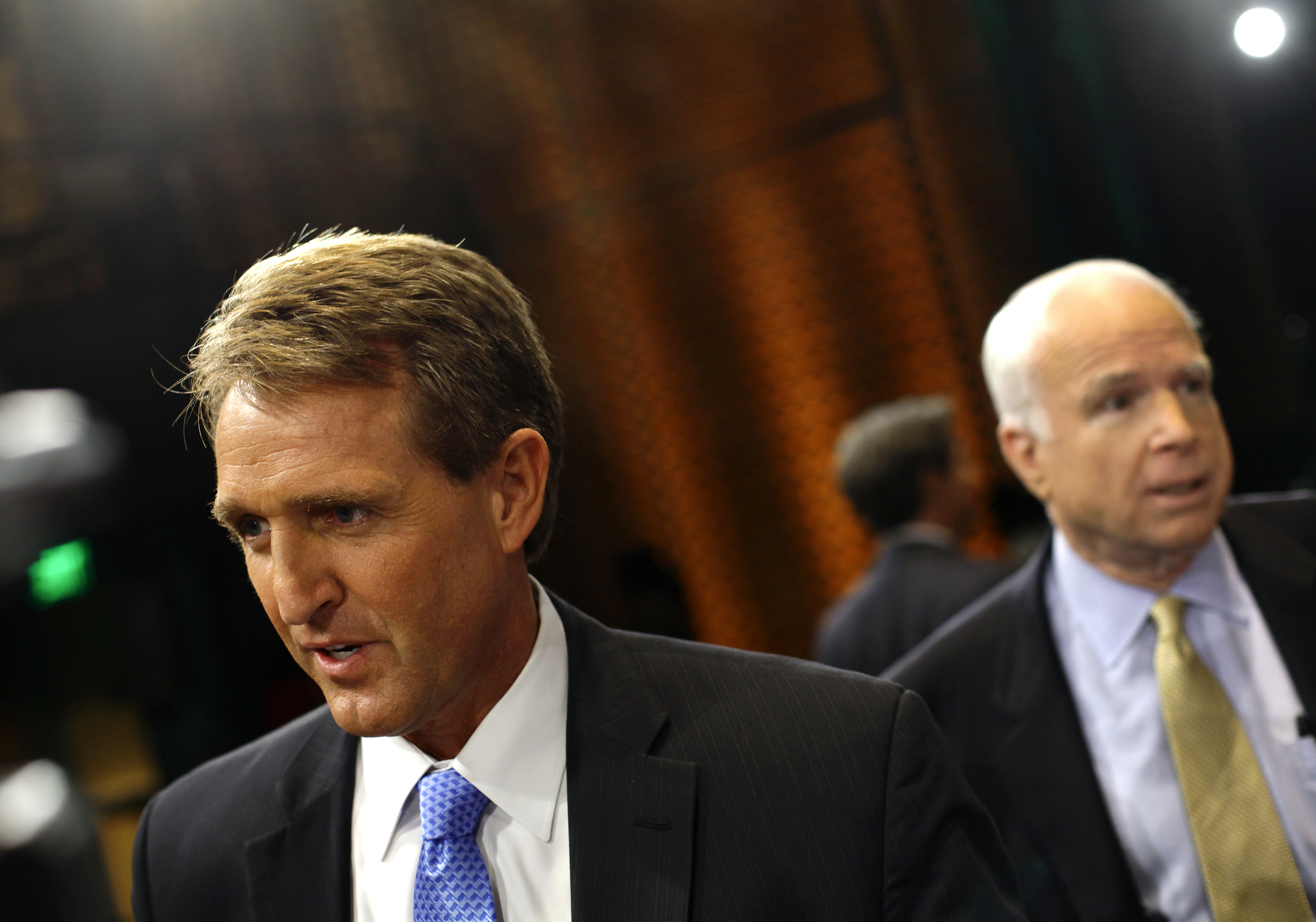 "U.S. Senator Jeff Flake (R-AZ) (L) and U.S. Senator John McCain (R-AZ) speak to reporters after attending a ""Conversation On Immigration"" during a town hall event in Mesa, Arizona August 27, 2013. McCain and Flake spoke about drugs entering the country illegally and businesses using E-Verify for employment eligibility when hiring workers. REUTERS/Joshua Lott (UNITED STATES - Tags: SOCIETY IMMIGRATION POLITICS) - RTX12Y6O"