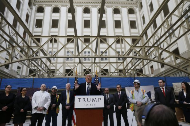 Republican presidential candidate Donald Trump speaks to the media during a news conference at the construction site of the Trump International Hotel at the Old Post Office Building in Washington, March 21, 2016