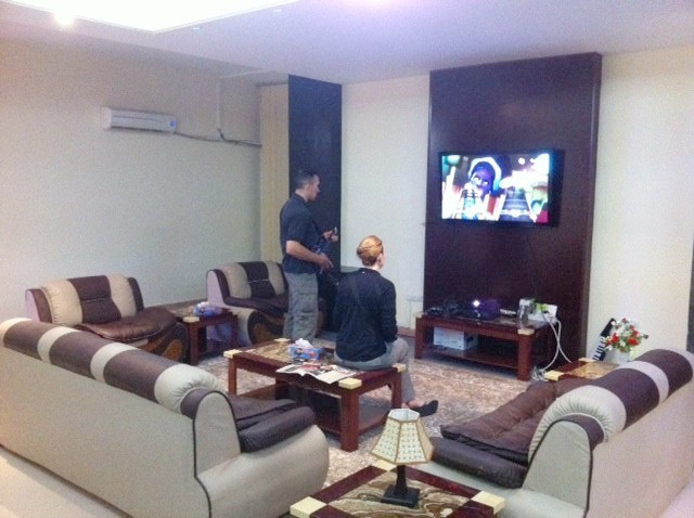 DOD task force employees play Guitar Hero in a luxurious Afghan villa. Photo: Courtesy of War is Boring