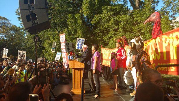 Bernie Sanders speaks at protest. (Steve Birr/TheDCNF)