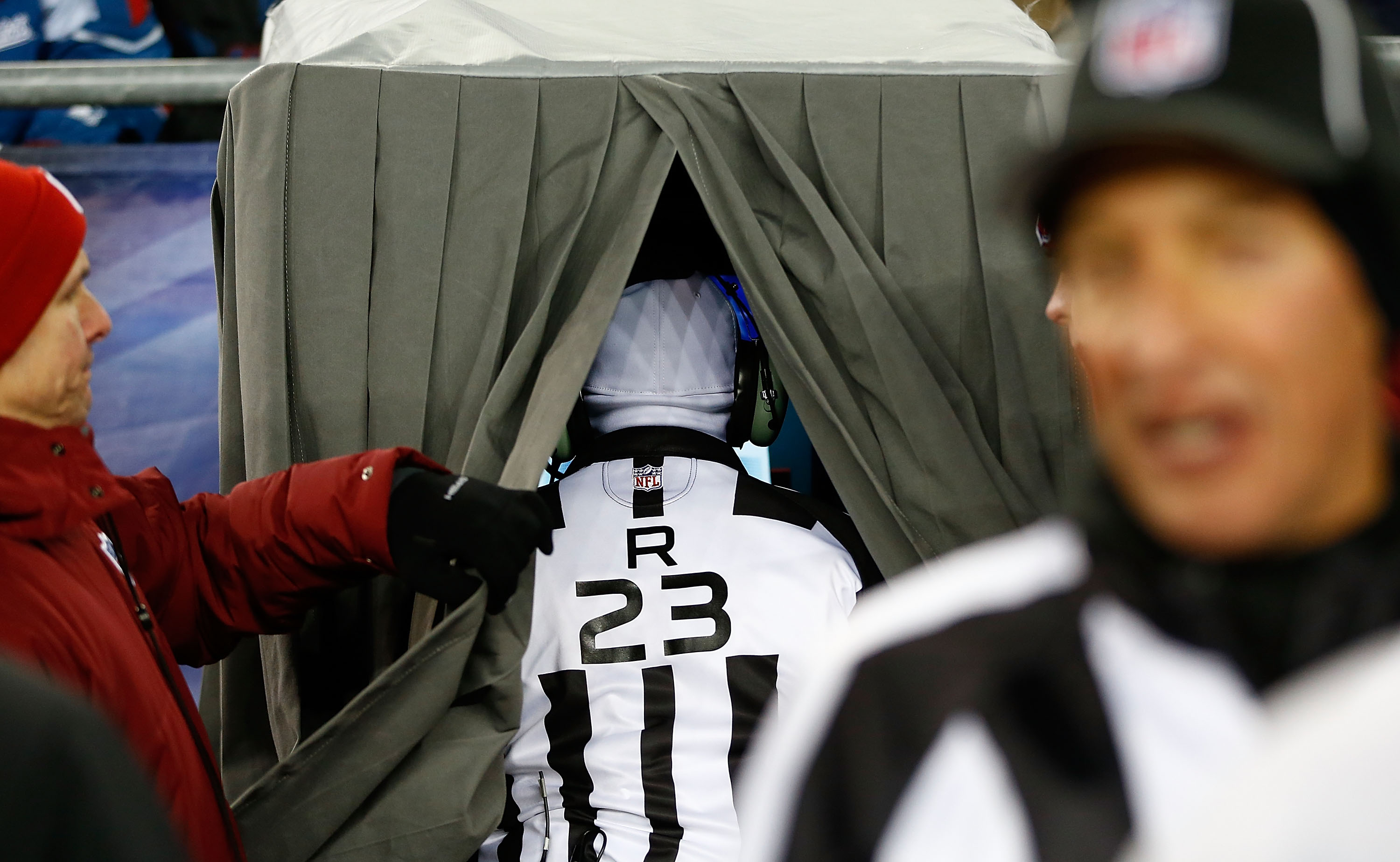 Referee Jerome Boger looks at the screen in the instant replay booth during the game between the Miami Dolphins and the New England Patriots at Gillette Stadium on December 30, 2012 (Getty Images)