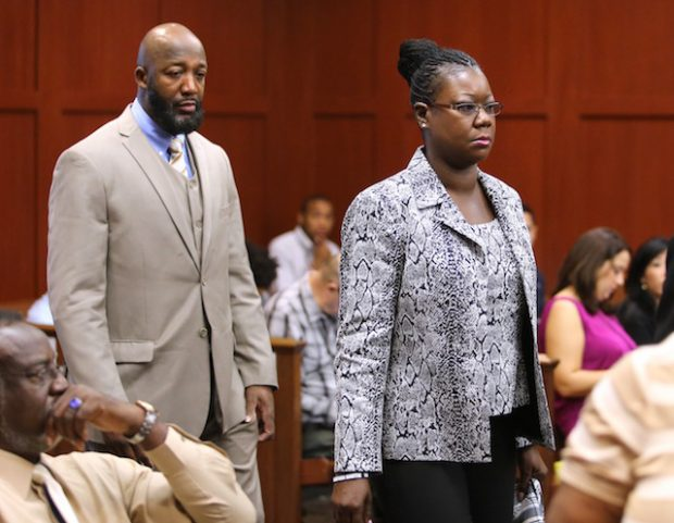 SANFORD, FL - JULY 9: The parents of Trayvon Martin, Tracy Martin and Sybrina Fulton, arrive in the courtroom for the George Zimmerman trial in Seminole circuit court, July 9, 2013 in Sanford, Florida. Zimmerman has been charged with second-degree murder for the 2012 shooting death of Trayvon Martin. (Photo by Joe Burbank-Pool/Getty Images)