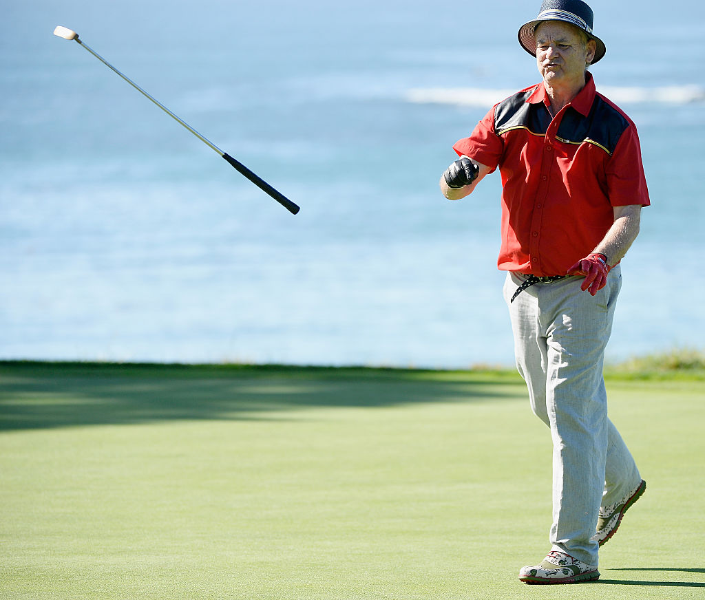 Actor Bill Murray tosses his putter on the fifth green during the third round of the AT&T Pebble Beach National Pro-Am at the Pebble Beach Golf Links on February 14, 2015 in Pebble Beach, California. (Photo by Harry How/Getty Images)