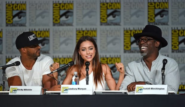 "SAN DIEGO, CA - JULY 10: (L-R) Actor Ricky Whittle, actress Lindsey Morgan and actor Isaiah Washington joke around as they attend a special video presentation and panel for ""The 100"" during Comic-Con International 2015 at the San Diego Convention Center on July 10, 2015 in San Diego, California. (Photo by Ethan Miller/Getty Images)"