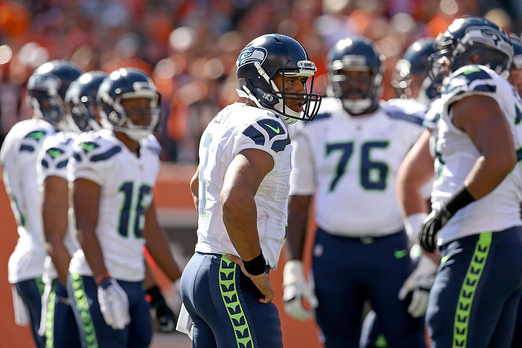 CINCINNATI, OH - OCTOBER 11: Russell Wilson #3 of the Seattle Seahawks looks to the sideline for the play before relaying it to his teammates during the second quarter of the game against the Cincinnati Bengals at Paul Brown Stadium on October 11, 2015 in Cincinnati, Ohio. (Photo by Andy Lyons/Getty Images)