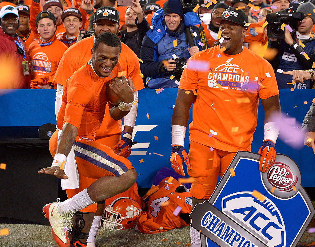 CHARLOTTE, NC - DECEMBER 05: Deshaun Watson #4 of the Clemson Tigers strikes the Heisman pose as he celebrates with teammates after a win against the North Carolina Tar Heels during the Atlantic Coast Conference Football Championship at Bank of America Stadium on December 5, 2015 in Charlotte, North Carolina. Clemson won 45-37. (Photo by Grant Halverson/Getty Images)