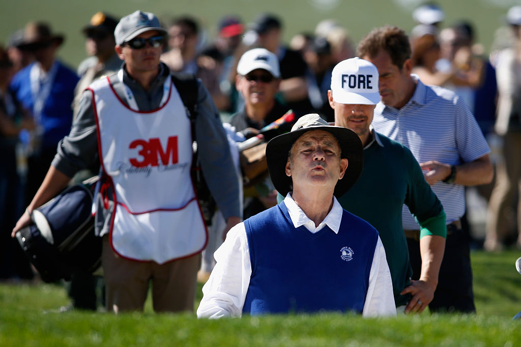 Murray follows his bunker shot at Pebble Beach. (Photo credit: Getty Images)