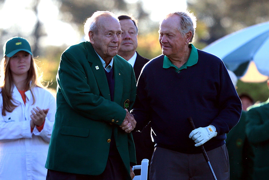 Honorary starters Jack Nicklaus and Arnold Palmer shake hands during the ceremonial tee off to start the first round of the 2016 Masters Tournament at Augusta National Golf Club. (Photo by Andrew Redington/Getty Images)