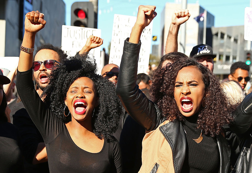 People dressed in black clothes rally to support the Black Lives Matter movement on July 17, 2016 in Melbourne, Australia (Getty Images)