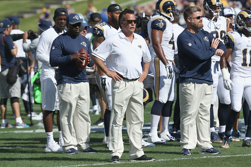 LOS ANGELES, CALIFORNIA - AUGUST 13: Head coach Jeff Fisher of the Los Angeles Rams works during warmups for the game against the Dallas Cowboys at the Los Angeles Coliseum during preseason on August 13, 2016 in Los Angeles, California. (Photo by Stephen Dunn/Getty Images)