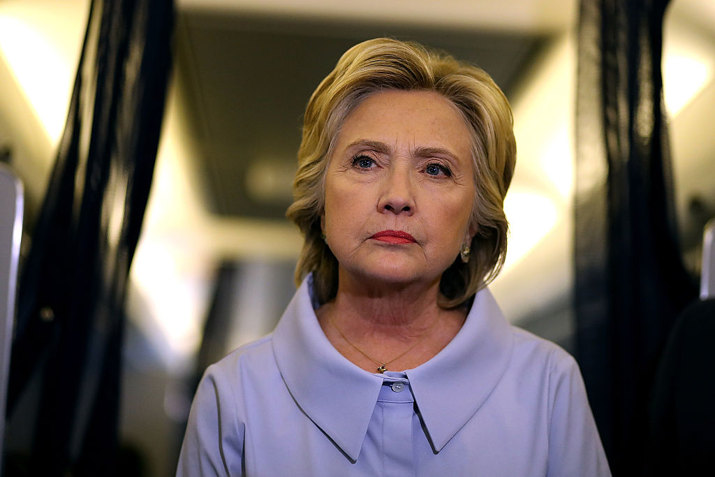 Hillary Clinton meets with reporters on her campaign plane on the way to Iowa on September 5, 2016. (Getty Images)