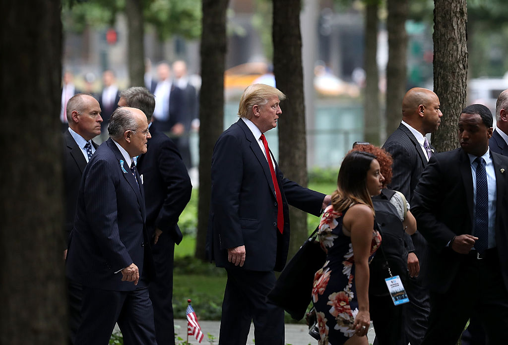 Donald Trump and former New York City mayor Rudy Giuliani arrive at September 11 Commemoration Ceremony at the National September 11 Memorial (Getty Images)