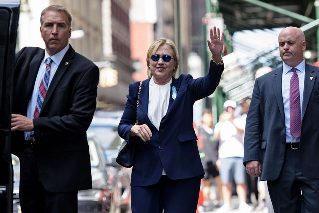 Hillary Clinton waves to the press as she leaves her daughter's apartment building after resting on September 11, 2016 in New York. Clinton departed from a remembrance ceremony on the 15th anniversary of the 9/11 attacks after feeling 'overheated,' but was later doing 'much better,' her campaign said