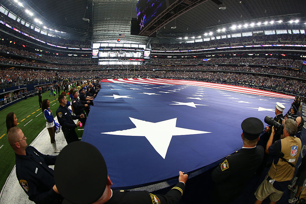 ARLINGTON, TX - SEPTEMBER 11: A general view of a giant American flag held on the field during pre-game ceremonies prior to the game between the Dallas Cowboys and New York Giants before at AT&T Stadium on September 11, 2016 in Arlington, Texas. (Photo by Tom Pennington/Getty Images)