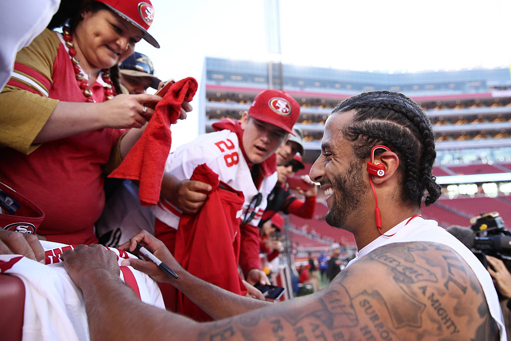 SANTA CLARA, CA - SEPTEMBER 12: Colin Kaepernick #7 of the San Francisco 49ers signs an autograph for a fan prior to playing the Los Angeles Rams in their NFL game at Levi's Stadium on September 12, 2016 in Santa Clara, California. (Photo by Ezra Shaw/Getty Images)