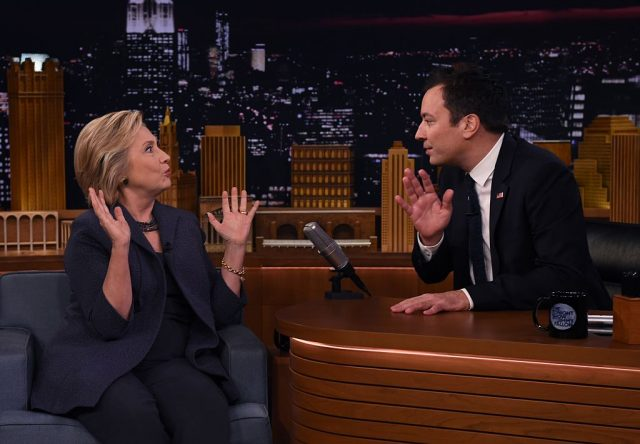 """Democratic presidential nominee Hillary Clinton speaks with talk show host Jimmy Fallon as she attends the taping of """"The Tonight Show with Jimmy Fallon"""" in New York, on September 16, 2016"""