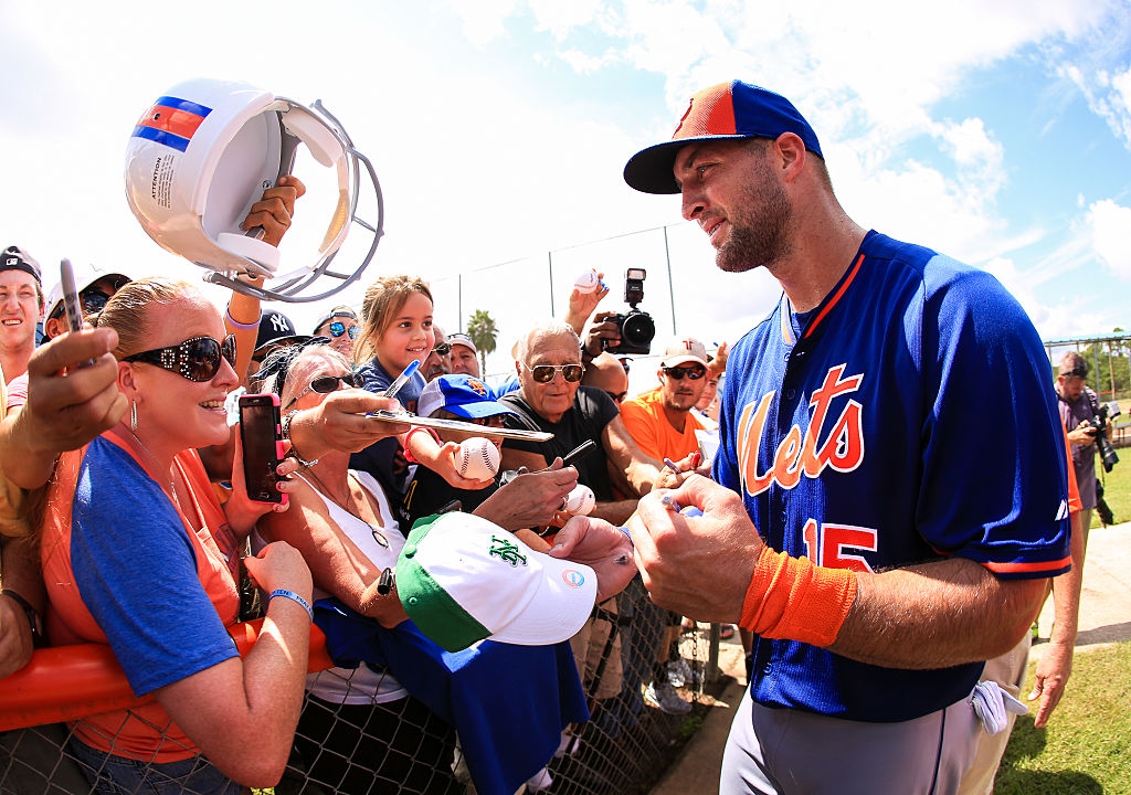 Tebow signs autographs at an instructional league practice (Photo credit: Getty Images)