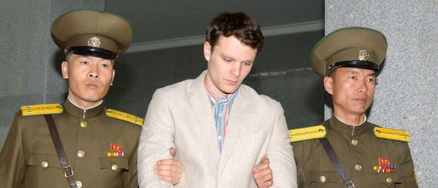 Otto Frederick Warmbier (C), a University of Virginia student who was detained in North Korea since early January, is taken to North Korea's top court in Pyongyang, North Korea, in this photo released by Kyodo March 16, 2016. North Korea's supreme court sentenced American student Warmbier, who was arrested while visiting the country, to 15 years of hard labour for crimes against the state, China's Xinhua news agency reported on Wednesday. Mandatory credit REUTERS/Kyodo