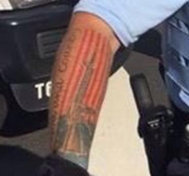 Twitter/Closeup of Officer Ian Litchermann's American flag tattoo