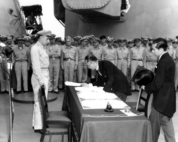 Japan signs unconditional surrender credit: Naval Historical Center Photo
