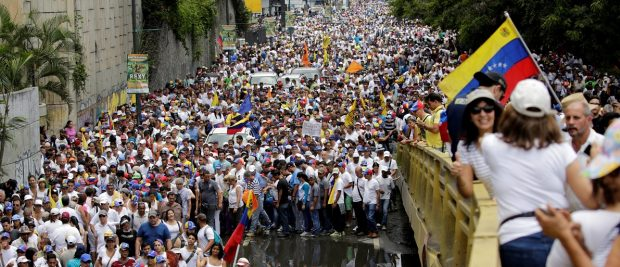 Opposition supporters take part in a rally to demand a referendum to remove Venezuela's President Nicolas Maduro in Caracas