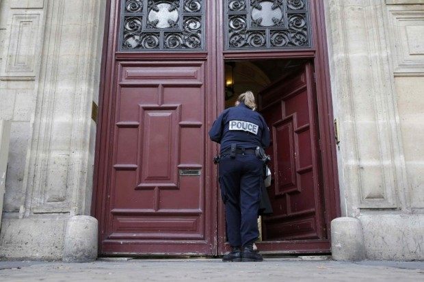 A police officer stands guard at the entrance of a luxury residence on the Rue Tronchet in central Paris, France, October 3, 2016 where masked men robbed U.S. reality TV star Kim Kardashian West at gunpoint early on Monday, stealing jewellery worth millions of dollars, police and her publicist said. REUTERS/Gonzalo Fuentes