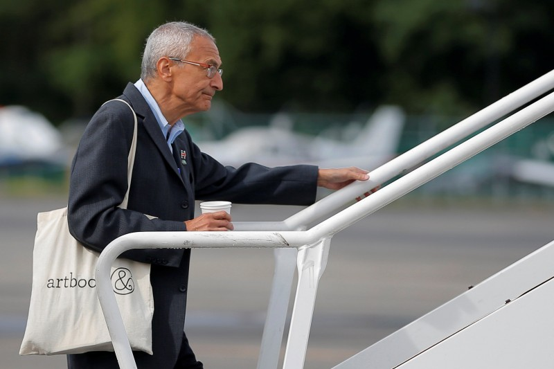 John Podesta boards Hillary Clinton's campaign plane in White Plains, New York (Reuters Pictures)