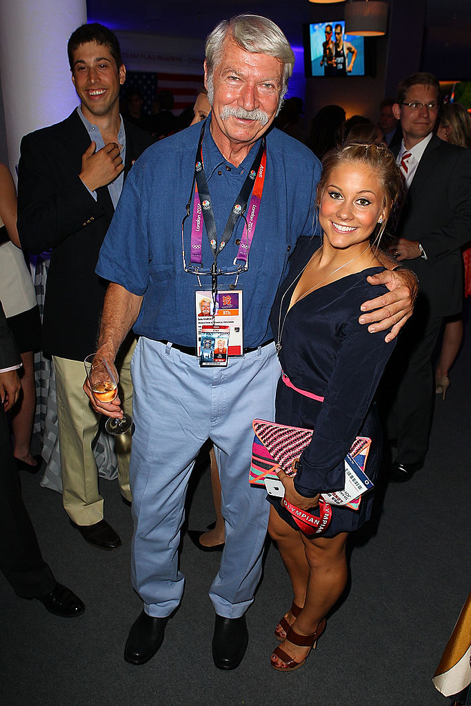 Gymnastics coach Bela Karolyi and U.S. Olympian Shawn Johnson attend the U.S. Olympic Committee Benefit Gala at USA House at the Royal College of Art on July 26, 2012 in London, England. (Photo by Joe Scarnici/Joe Scarnici/Getty Images)