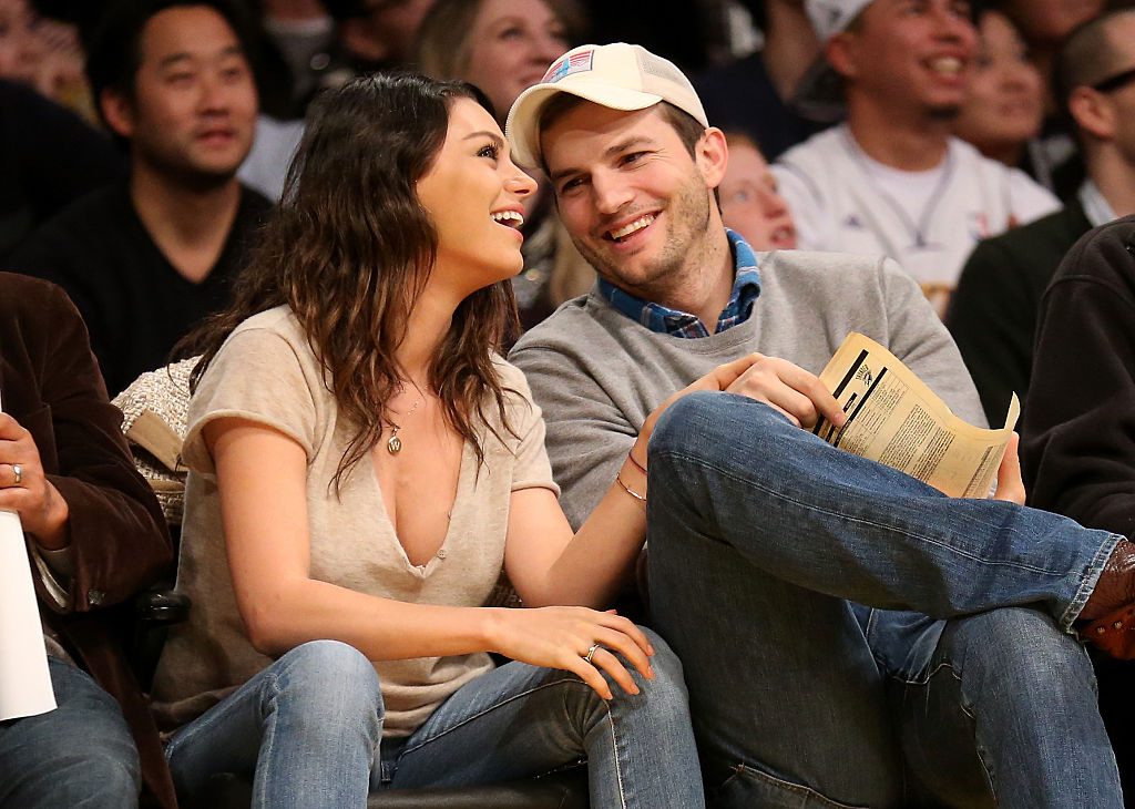 Ashton Kutcher and Mila Kunis attend a LA Lakers game. (Photo by Stephen Dunn/Getty Images)