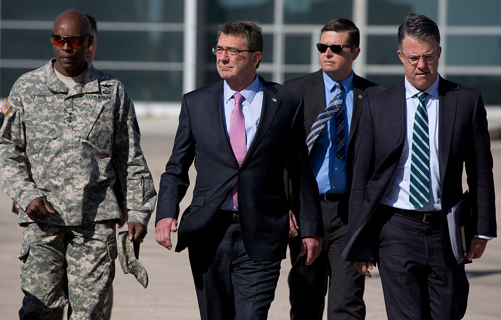U.S. Defense Secretary Ash Carter, accompanied by his Chief of Staff Eric Rosenbach (R) and U.S. Army Lt. Gen. Ron Lewis (L) walks on the tarmac before boarding his plane en route to Irbil, Iraq (Getty Images)