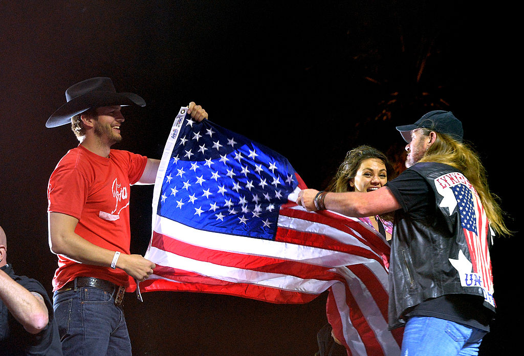 Actors Ashton Kutcher, Mila Kunis and singer Johnny Van Zant of Lynyrd Skynyrd onstage during day 1 of the 2014 Stagecoach Festival (Getty Images)