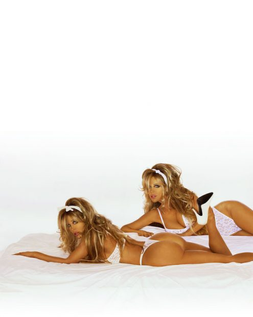 """390609 07: Pinup Models Shane And Sia Barbi Pose For A Portrait June 2, 2001 In Los Angeles, Ca. Their Latest Book, """"Barbi Twins, Dying To Be Healthy: Millennium Dieting And Nutrition"""" Talk About Their Life And Death Struggle With Eating Disorders. (Photo By Getty Images)"""