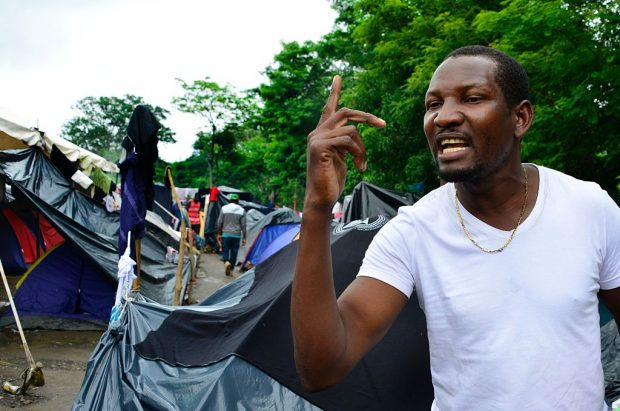 Congolese migrant Samuel Yeaye Omar speaks in an encampment of Africans in Penas Blancas, Guanacaste, Costa Rica, in the border with Nicaragua on July 19, 2016. In a makeshift camp at barely one kilometer from the border, hundreds of tents shelter Haitians, Congolese, Senegalese and Ghanahian migrants waiting to continue their journey to the United States. / AFP / Ezequiel Becerra / TO GO WITH AFP STORY BY MARCO SIBAJA (Photo credit should read EZEQUIEL BECERRA/AFP/Getty Images)