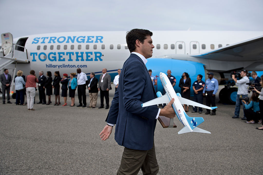 Nick Merrill carries a plane model as Democratic US Presidential candidate Hillary Clinton greets flight crew and others at Westchester County Airport (Getty Images)