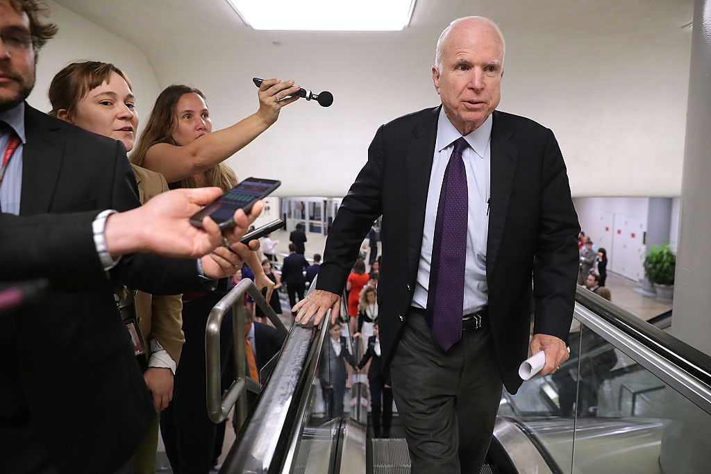 John McCain is pursued by reporters as he heads for a vote at the U.S. Capitol on September 6, 2016 (Getty Images)
