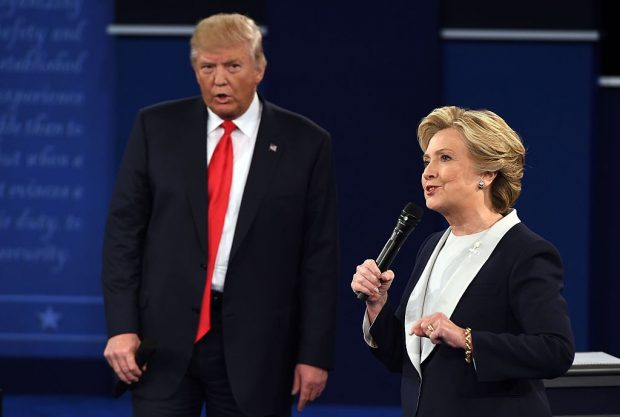 TOPSHOT - US Democratic presidential candidate Hillary Clinton and US Republican presidential candidate Donald Trump debate during the second presidential debate at Washington University in St. Louis, Missouri, on October 9, 2016. (ROBYN BECK/AFP/Getty Images)