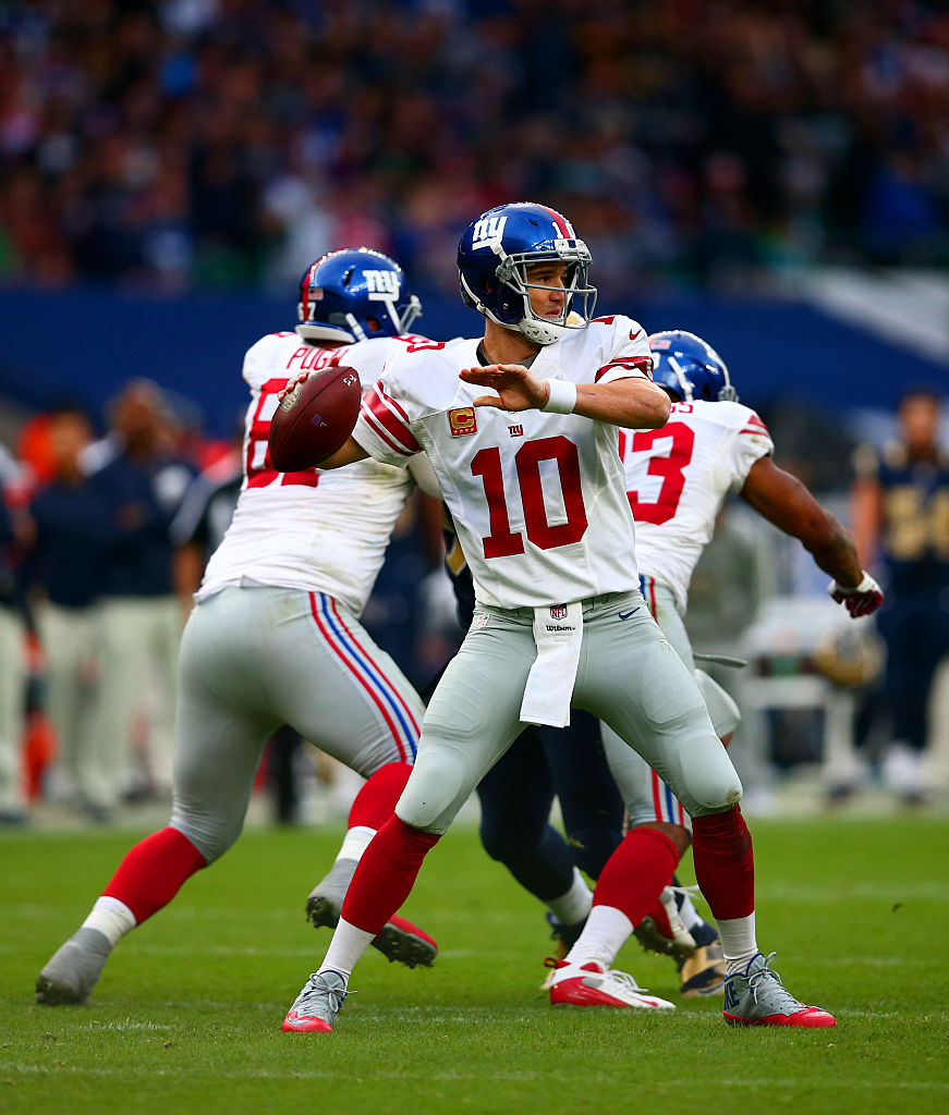 Manning drops back to pass during the NFL International series game between Los Angeles Rams and New York Giants in London, England. (Photo credit: Getty Images)