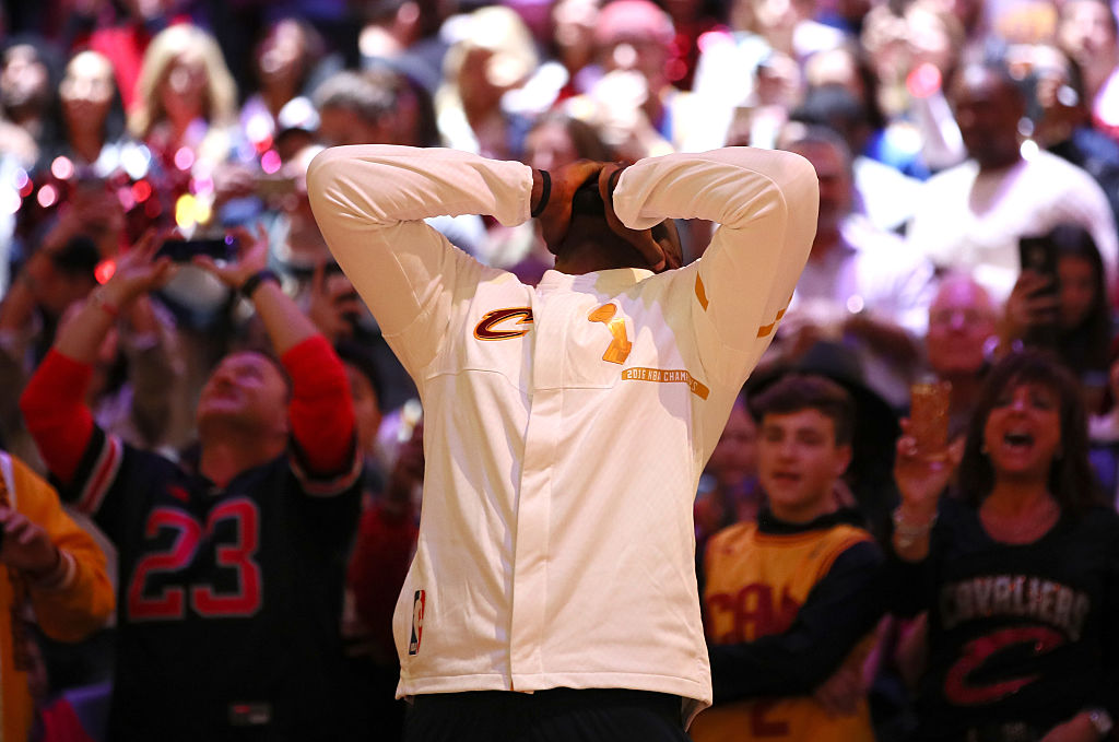 LeBron James reacts during the championship banner raising and ring ceremony before the game against the New York Knicks. (Photo by Ezra Shaw/Getty Images)