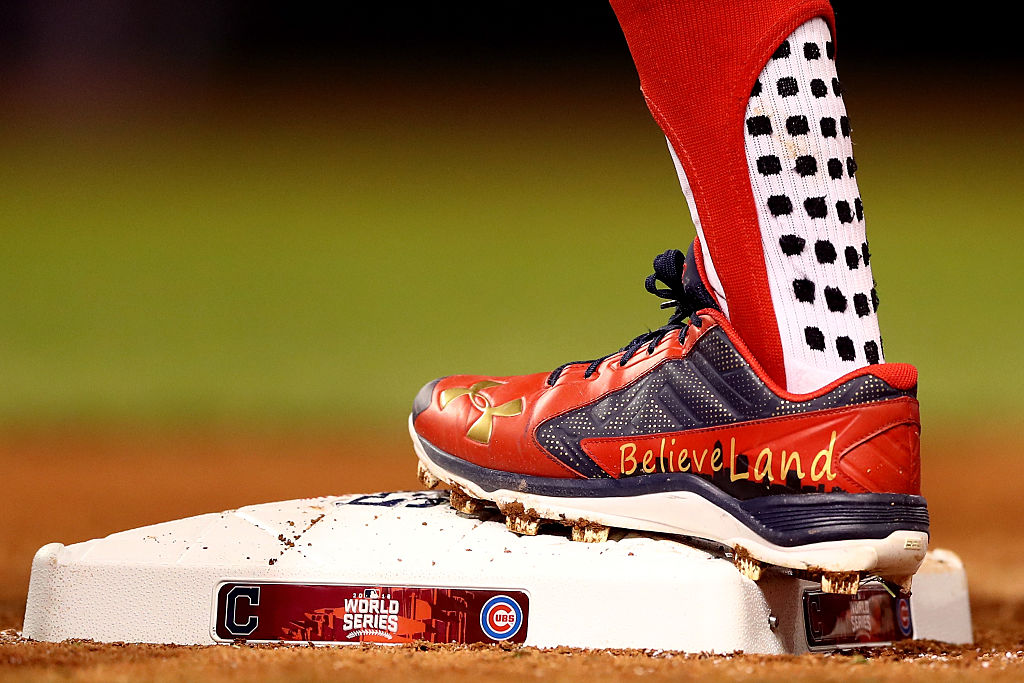 """Francisco Lindor #12 of the Cleveland Indians cleats sporting the city's new nickname """"BelieveLand"""" in Game One of the 2016 World Series. (Photo by Elsa/Getty Images)"""