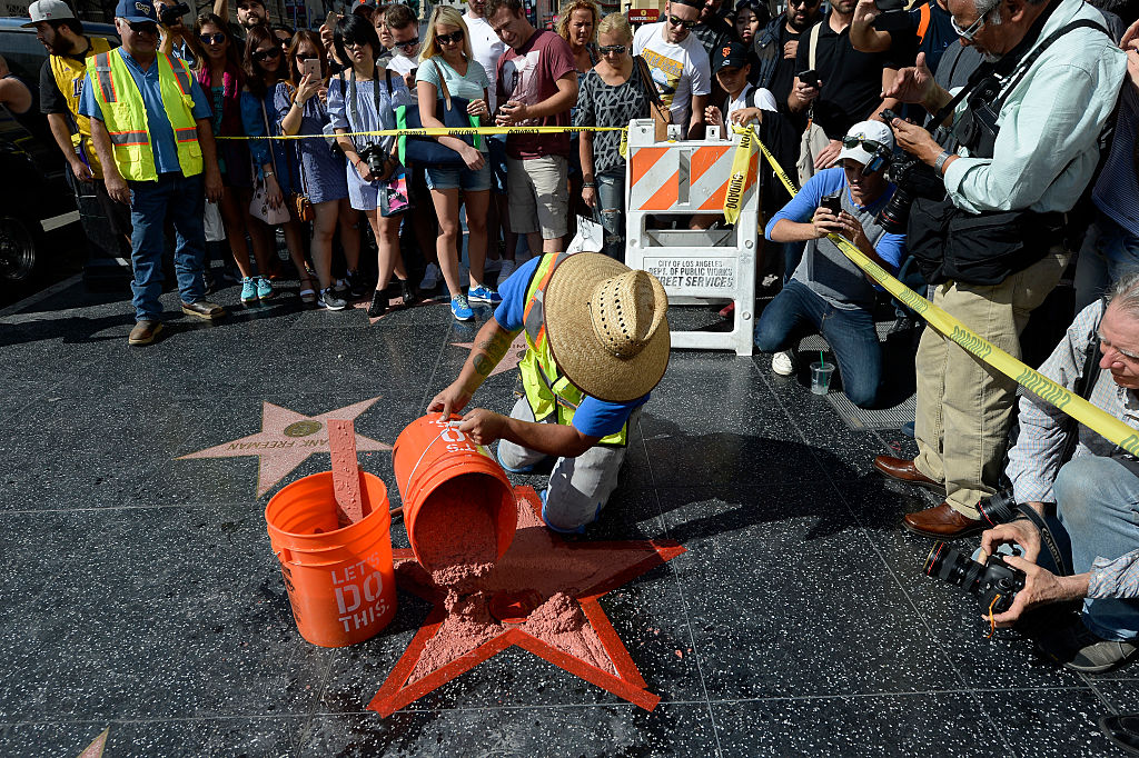 Donald Trump's 'Hollywood Walk Of Fame Star under repair after being destroyed . (Photo by Kevork Djansezian/Getty Images)