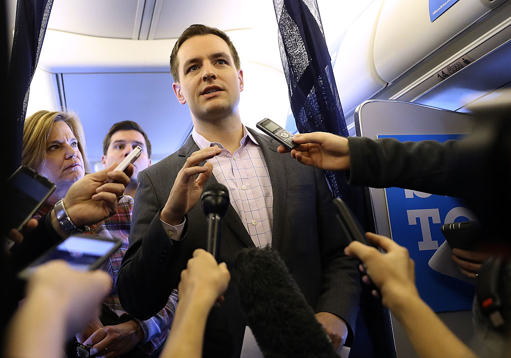 Hillary Clinton's campaign manager Robby Mook speaks to press onboard her campaign plane (Getty Images)