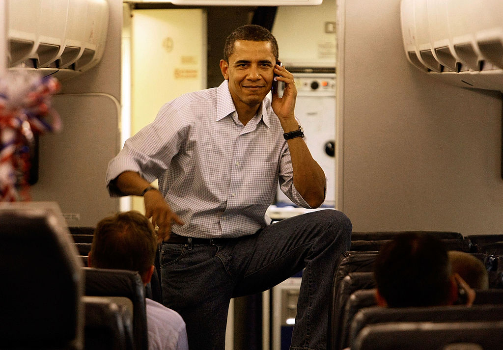 CHICAGO, IL- MAY 07: Democratic presidential hopeful Sen. Barack Obama (D-IL) talks on his cell phone as he boards his campaign plane at Midway Airport en-route to Washington DC, May 7, 2008 in Chicago, Illinois. (Getty Images)